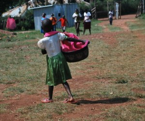 Child with Laundry Basket_100293614_